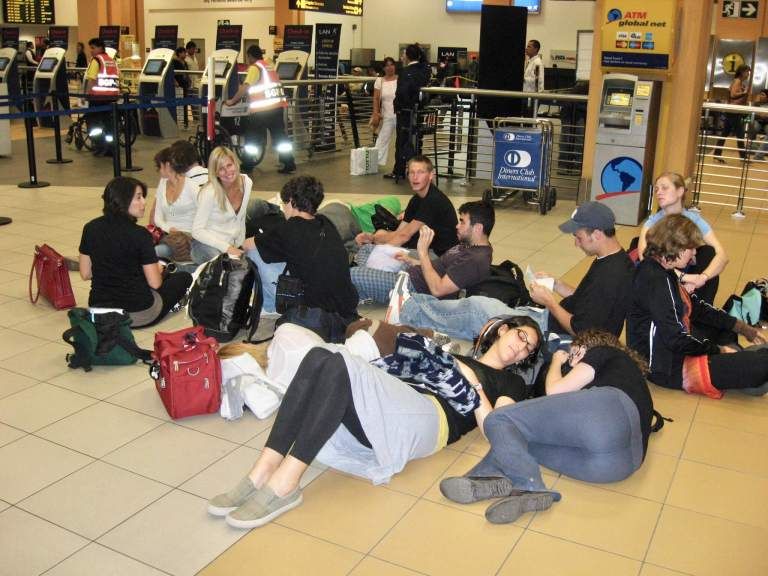 Group on the floor waiting at the Lima Airport