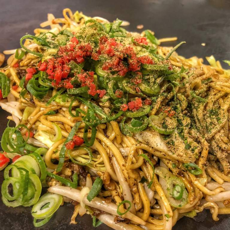 Fried noodles with scallions and other garnishes