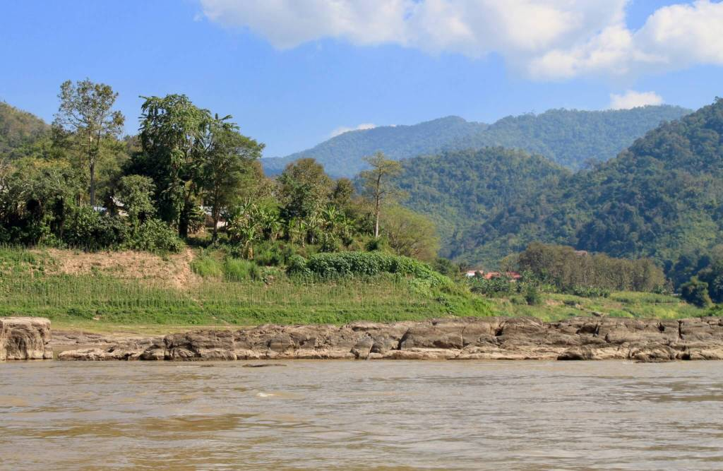 Green hills and mountains seen from the river