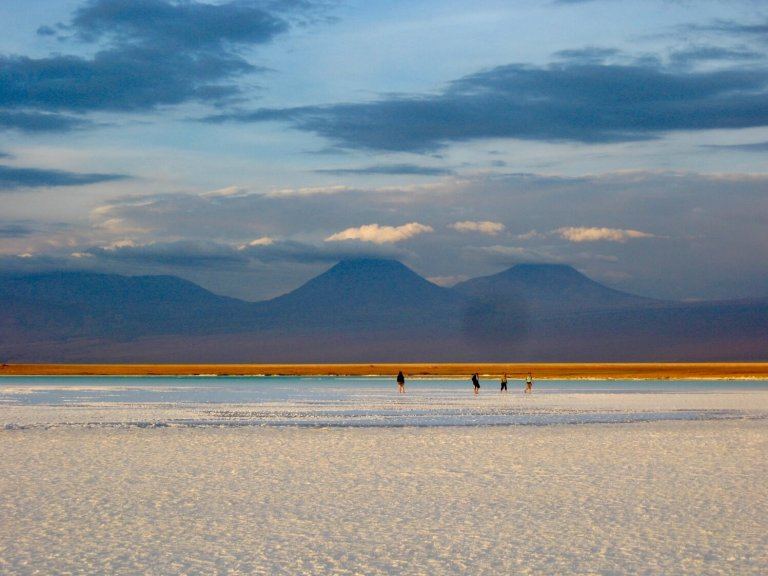 People in the distance on the salt flats of the Salar de Atacama