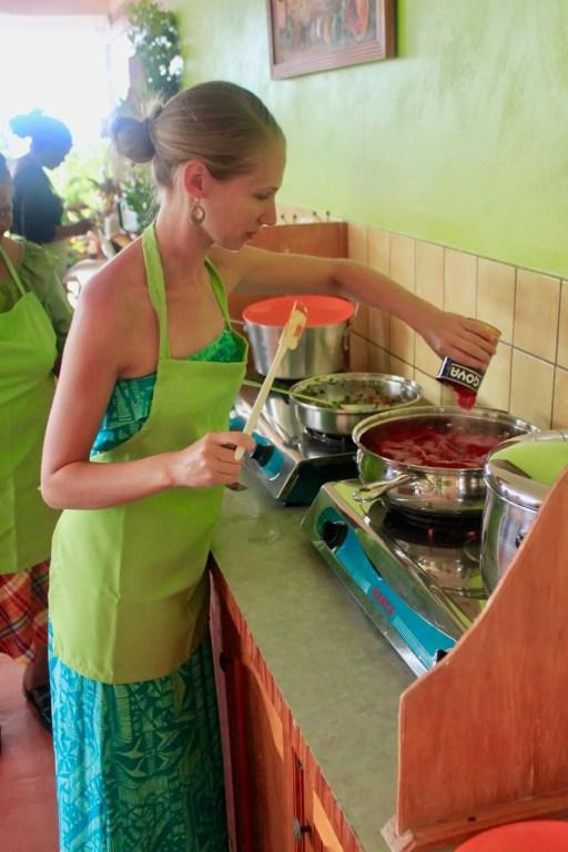 Gwen adding ingredients to the fish stew