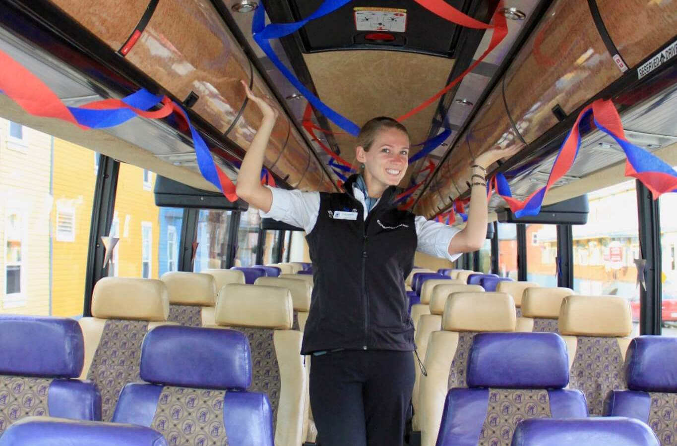 Gwen standing in a tour bus outfitted with red and blue streamers