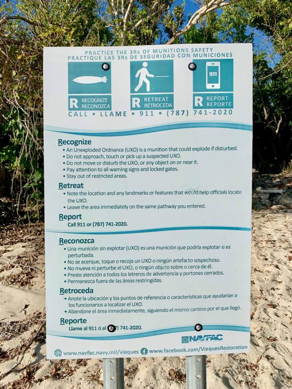 Sign on a beach in Vieques explaining the risk of unexploded ordnance