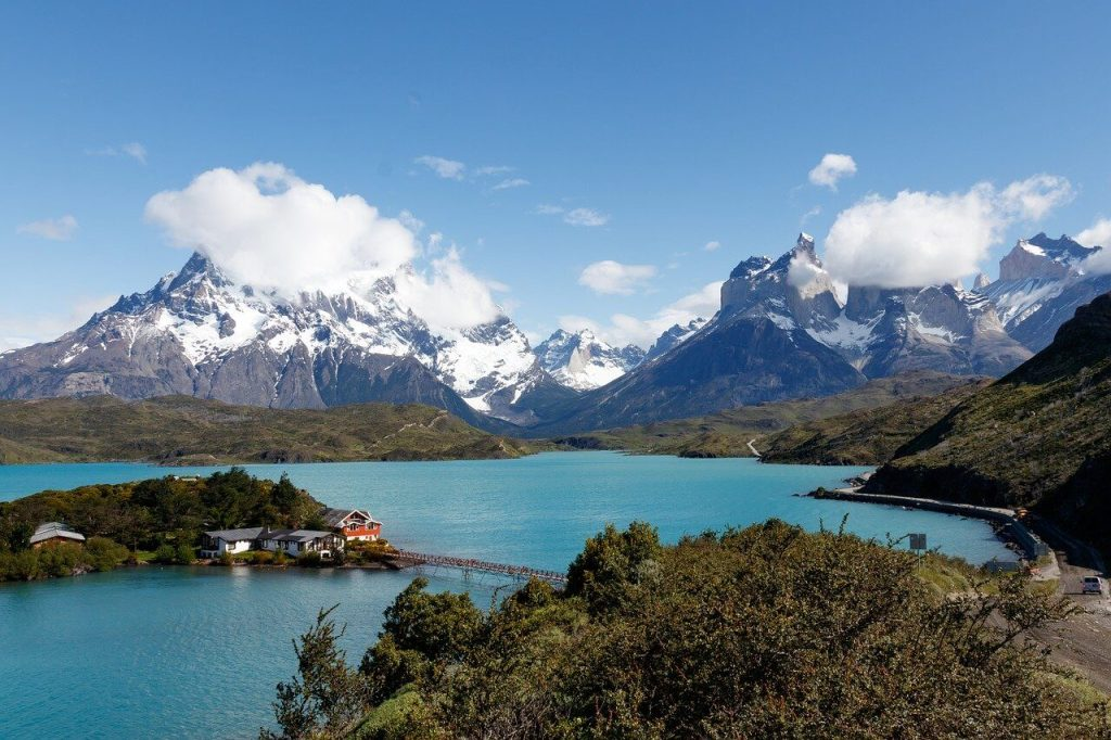 Teal-colored lake and snow-capped mountains in Torres del Paine National Park, Chile