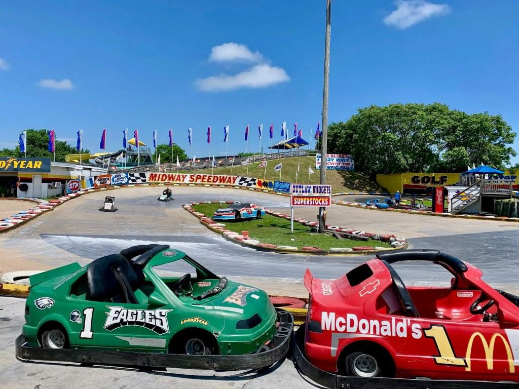 Two go-karts speeding around Midway Speedway