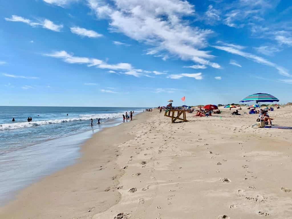 Blue sky over the beach at Delaware Seashore State Park, one of the best things to do in Rehoboth Beach Delaware