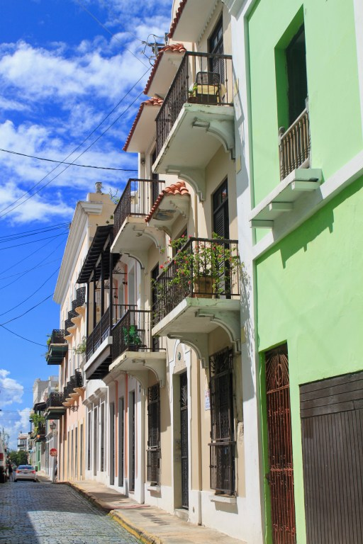 Colorful buildings with balconies and flowers on the streets of Old San Juan