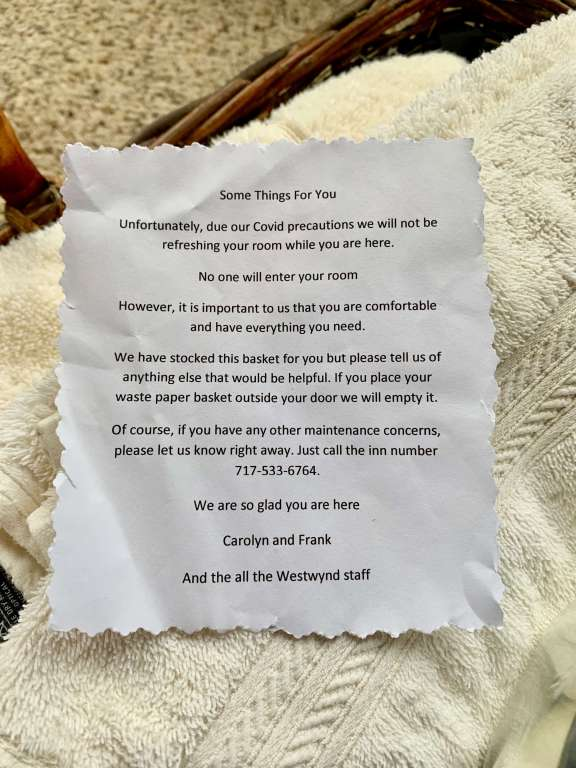 Note from innkeepers stating that they won't be entering the room but to enjoy the basket