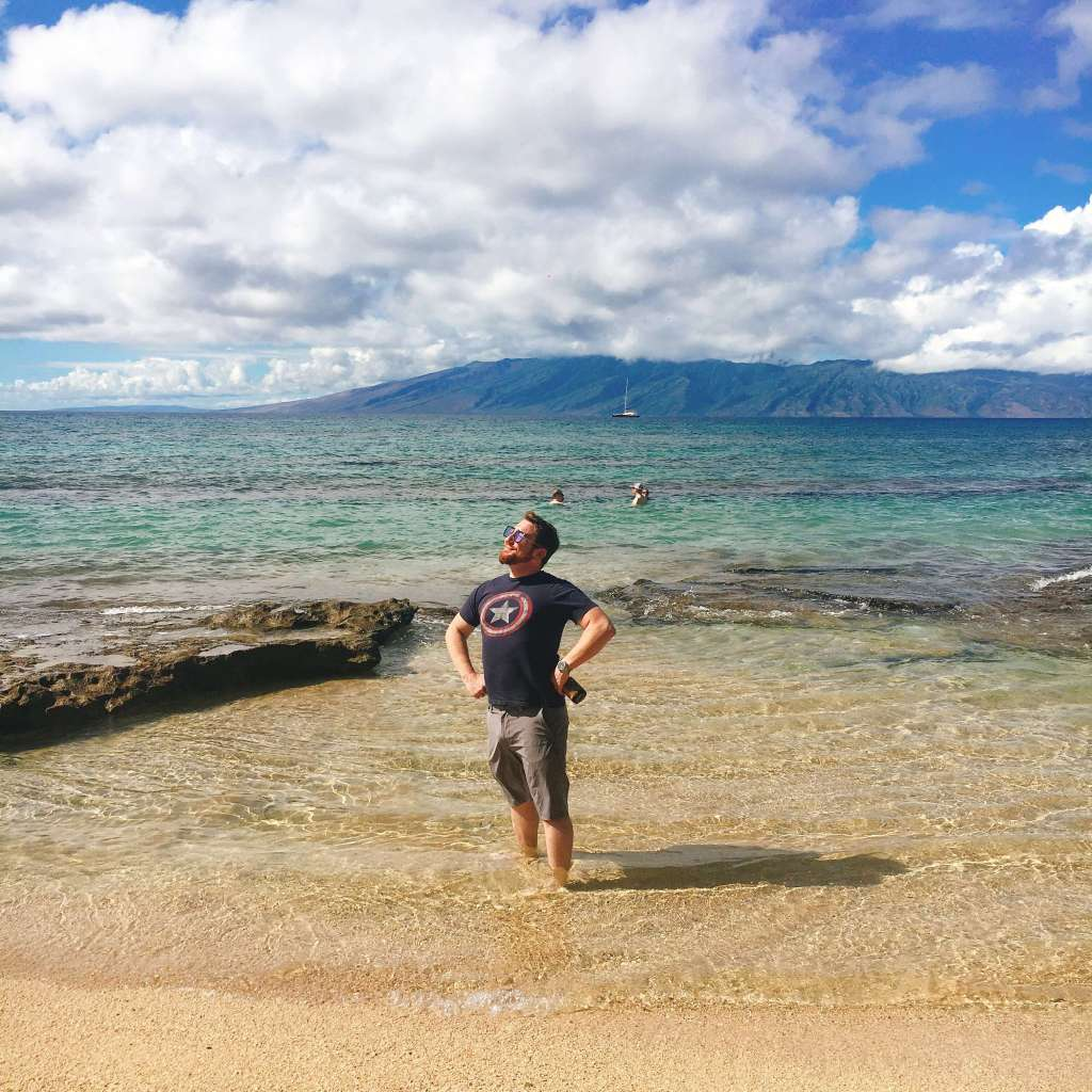 Jeff, an expert on Maui food, strikes a pose on a gorgeous Hawaiian beach