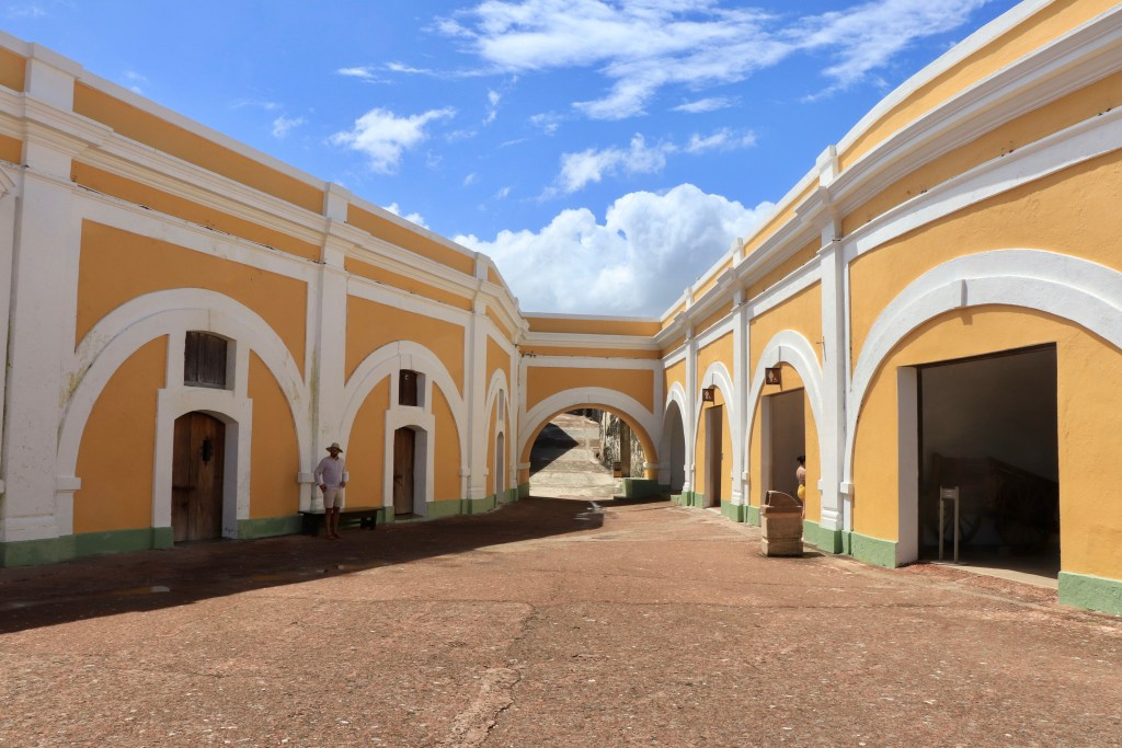 Yellow Plaza de Armas with bright blue sky