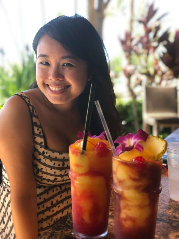 Erica posing with Mai Tais - a Maui food must!