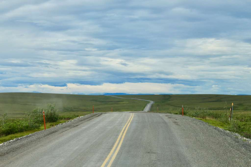 The Dalton Highway in Alaska stretching in the horizon
