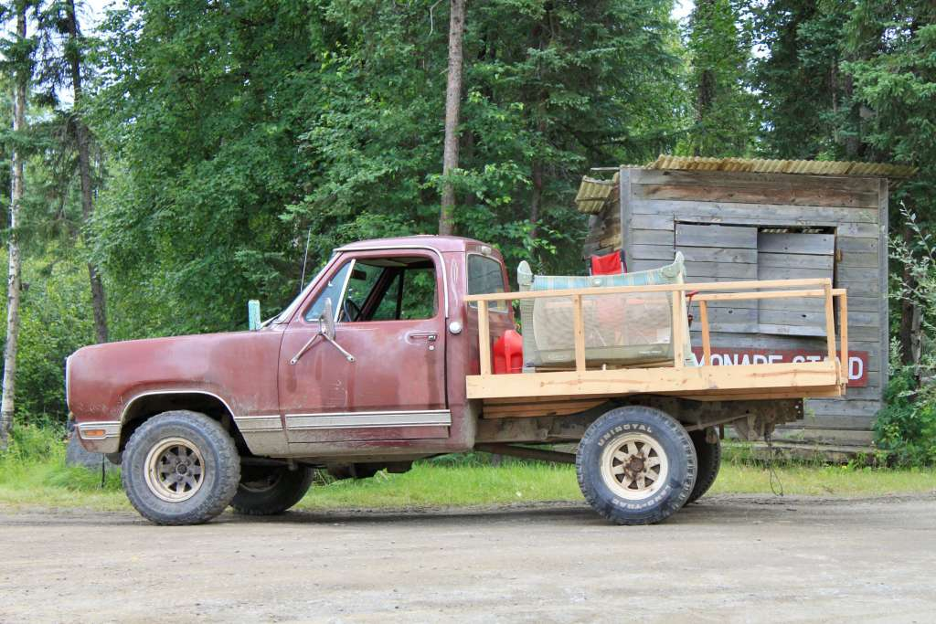 Pickup truck with baby's pack-and-play in the bed.