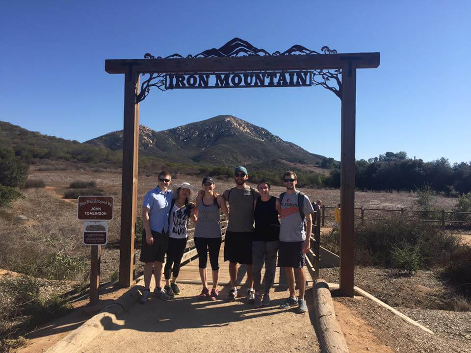Group photo under the Iron Mountain sign