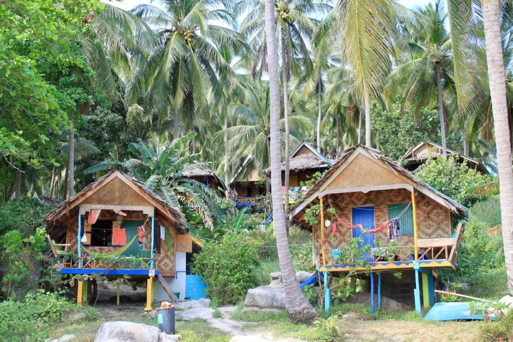Colorful wooden bungalows on a beach in Thailand