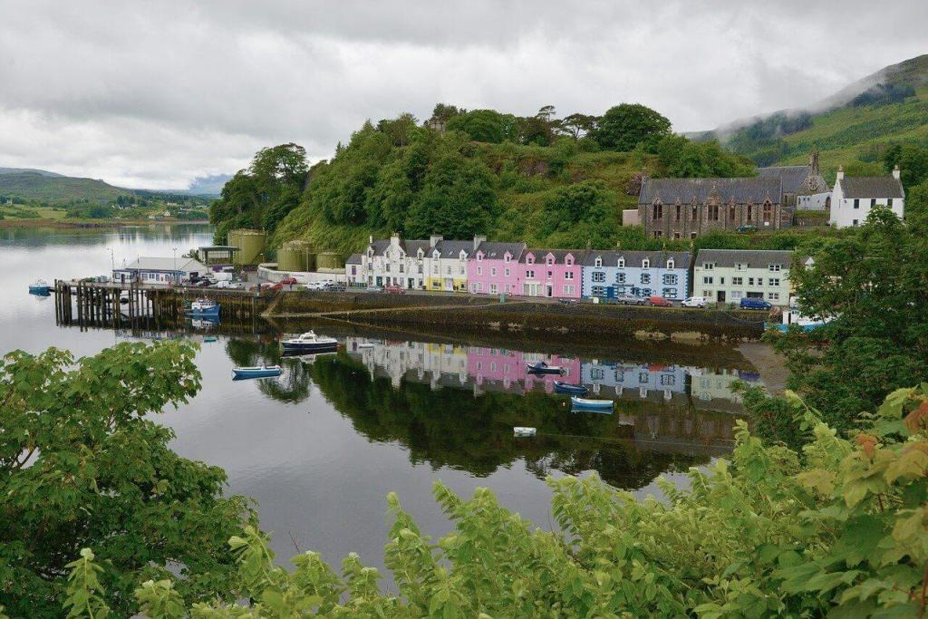 Colorful buildings along the harbor in Portree, the first stop on this driving itinerary for the Isle of Skye