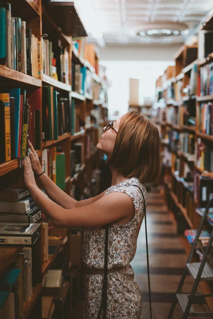 A lady finding a book to educate and develop herself