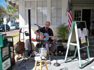 Bill Vilhage plays in front of The Historic Peninsula Inn