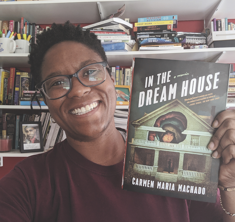 "Sheree Greer holds a copy of the book ""In the Dream House"""