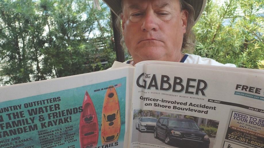 Man reading the Gabber Newspaper Gulfport Florida