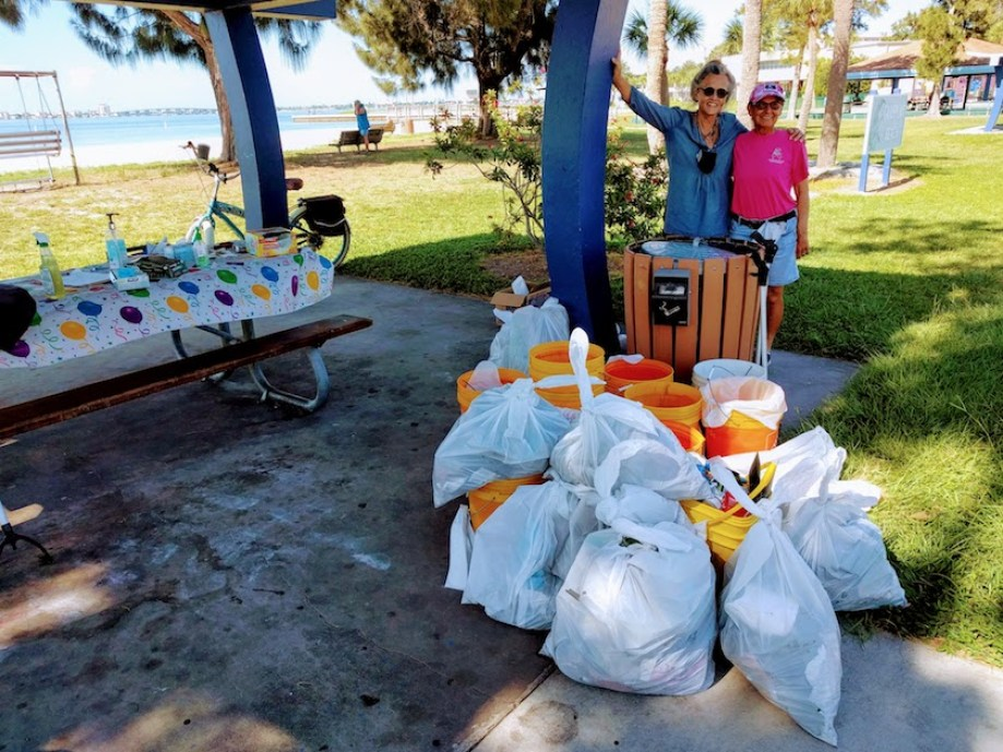 Marcella Ruso, left, and Deb Laramee represent with the many bags of trash