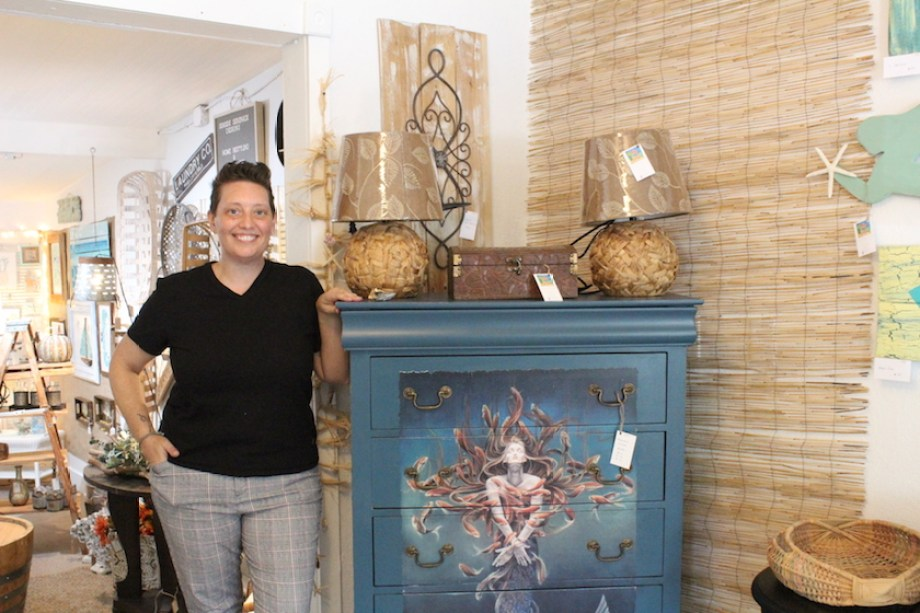 Jamie Edwards poses next to her creation at her new artist haven Beach House 5317.