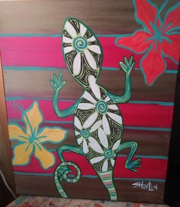 Abstract art featuring a gecko in greens and reds.