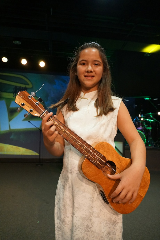 Siri Yun holding a small guitar