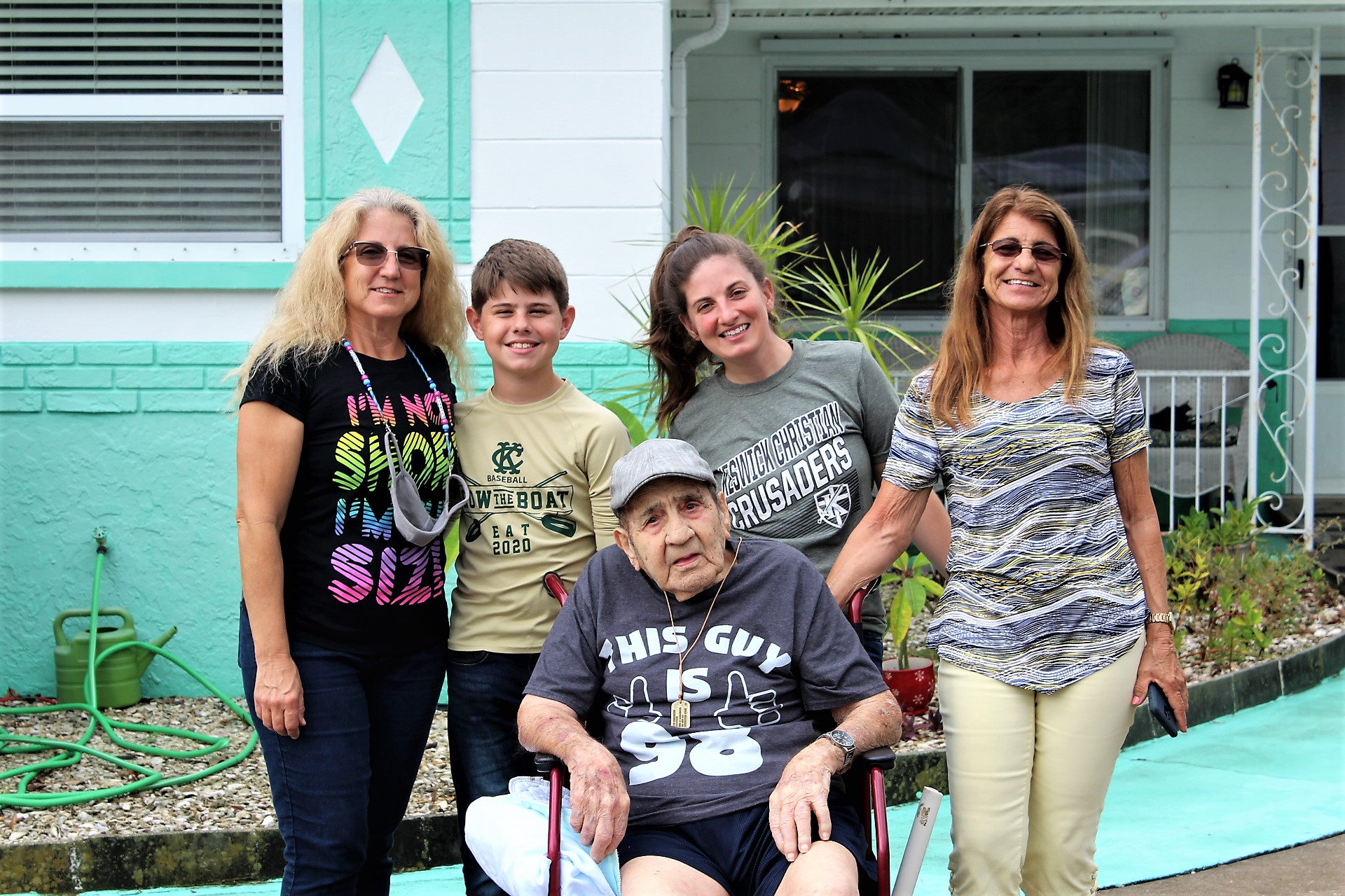 Sylvio Cucuruto, surrounded by family on his 98th birthday, in front of his Gulfport home. They arranged for the Gulfport Police Department and the Gulfport Fire Rescue to do a celebratory drive-by. From left with him are daughter Carole, great-grandson Logan, granddaughter Breanna and daughter Sylvia.