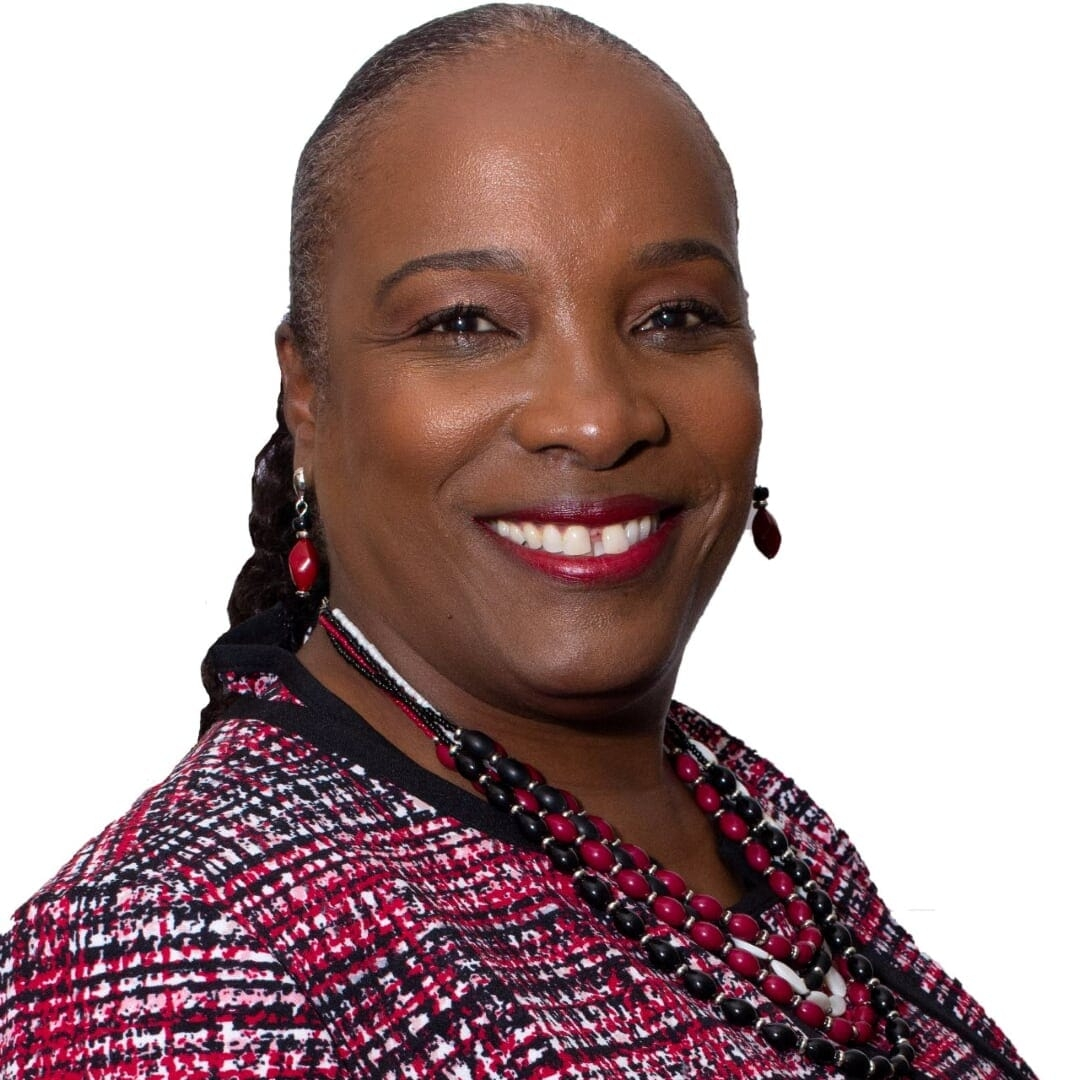 Head shot of a woman in a plaid suit.