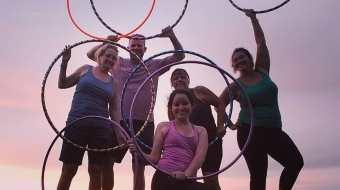 People holding hula hoops
