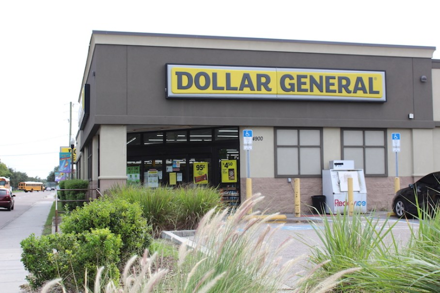 "A photo of the outside of Dollar General with a yellow sign that reads ""Dollar General."""