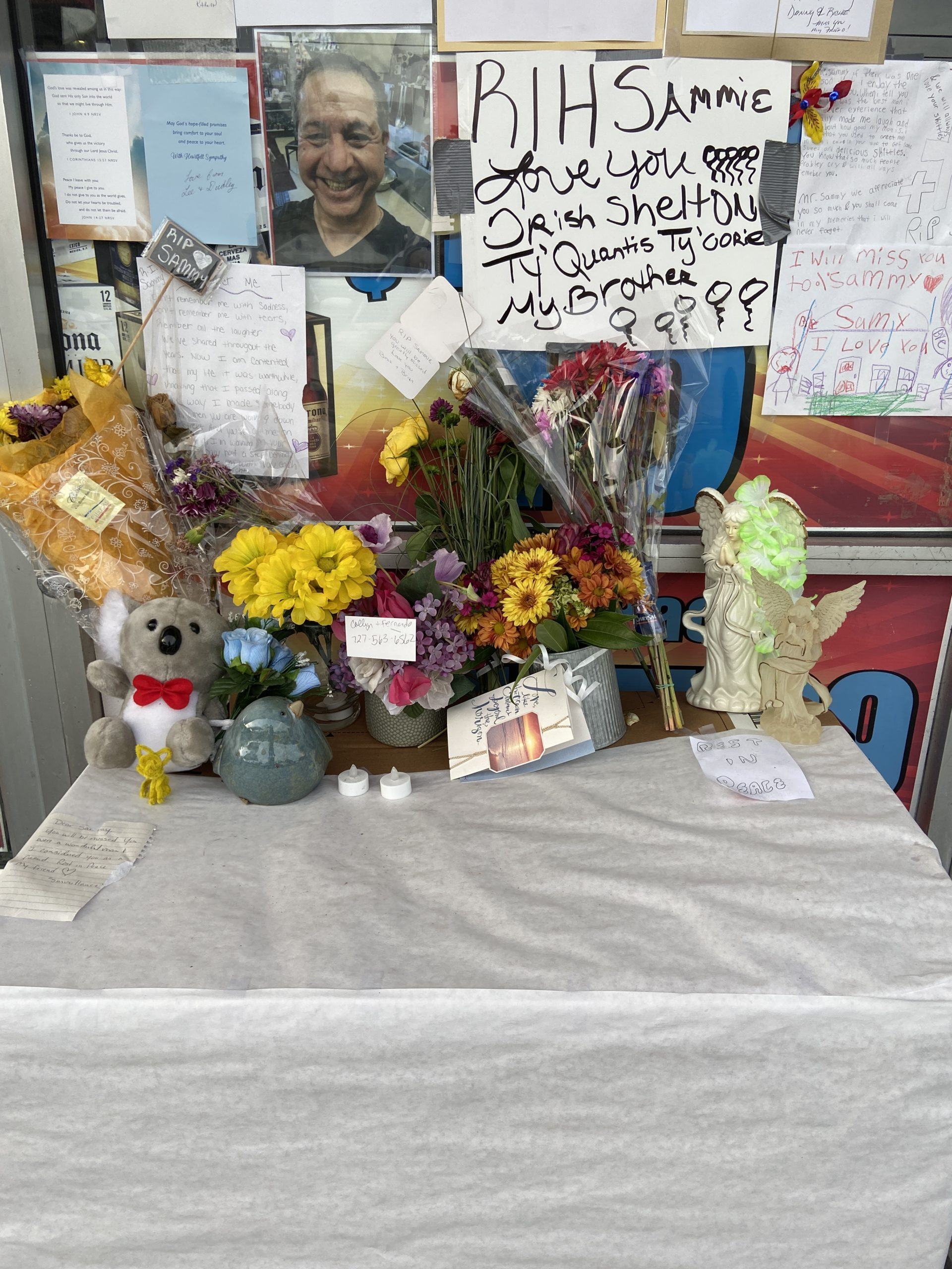 A memorial with cards, posters and photos.