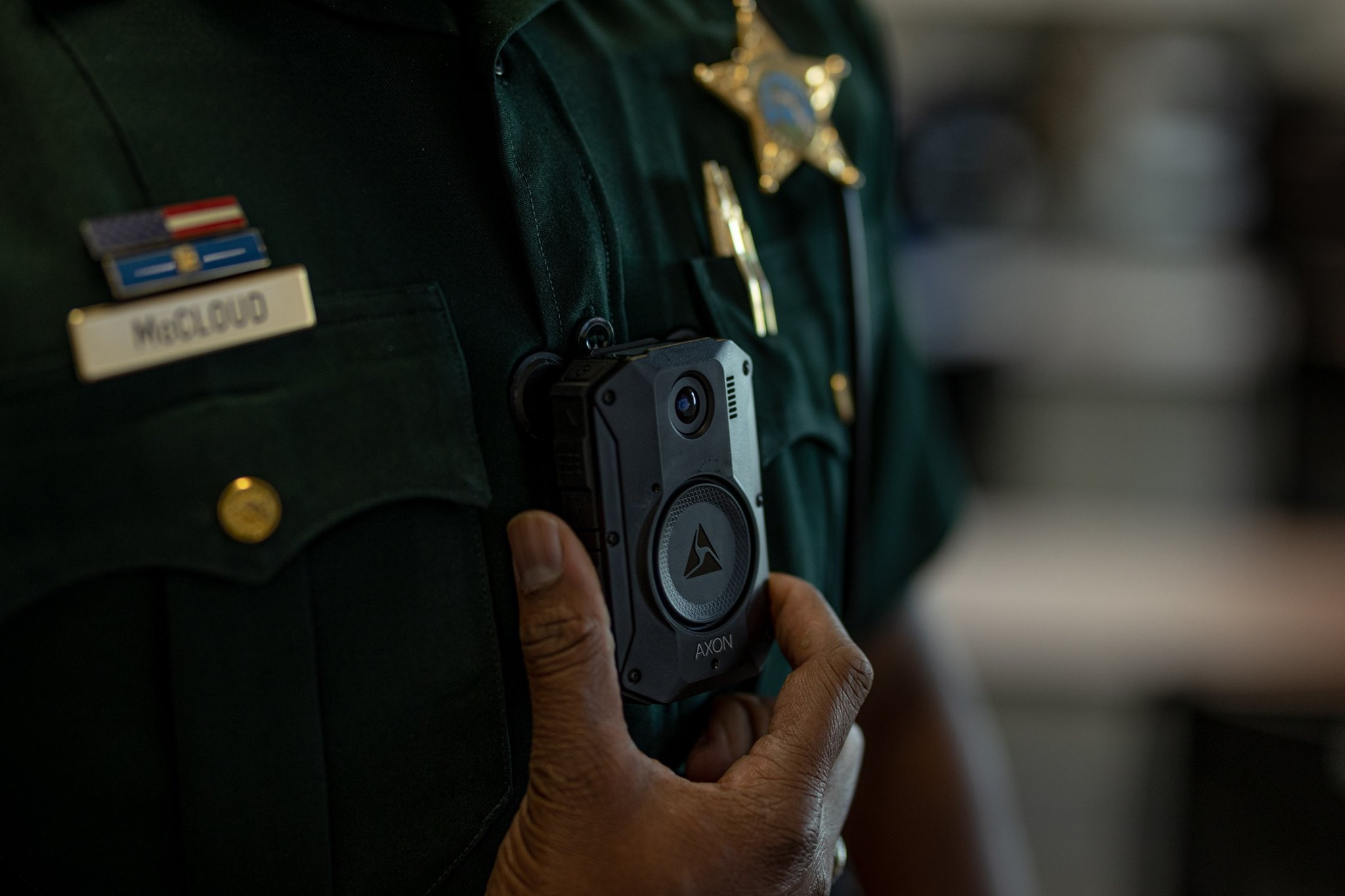 A body camera close up on a police officer.