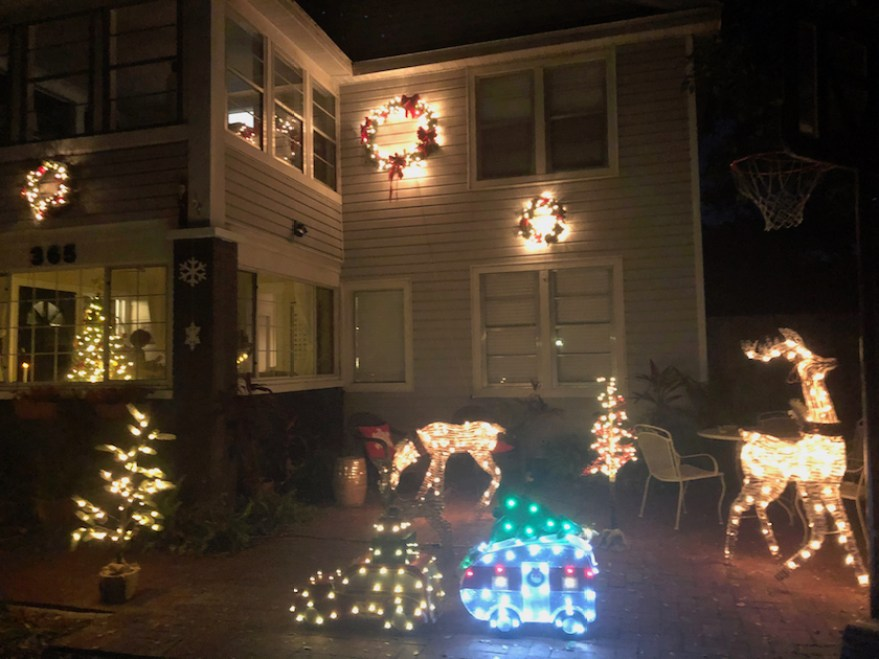 A house at night with holiday lights and decoration.