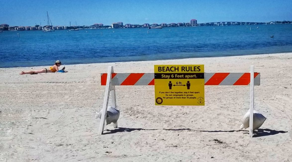 Beach rules sign on Gulfport Beach. Photo by June Johns