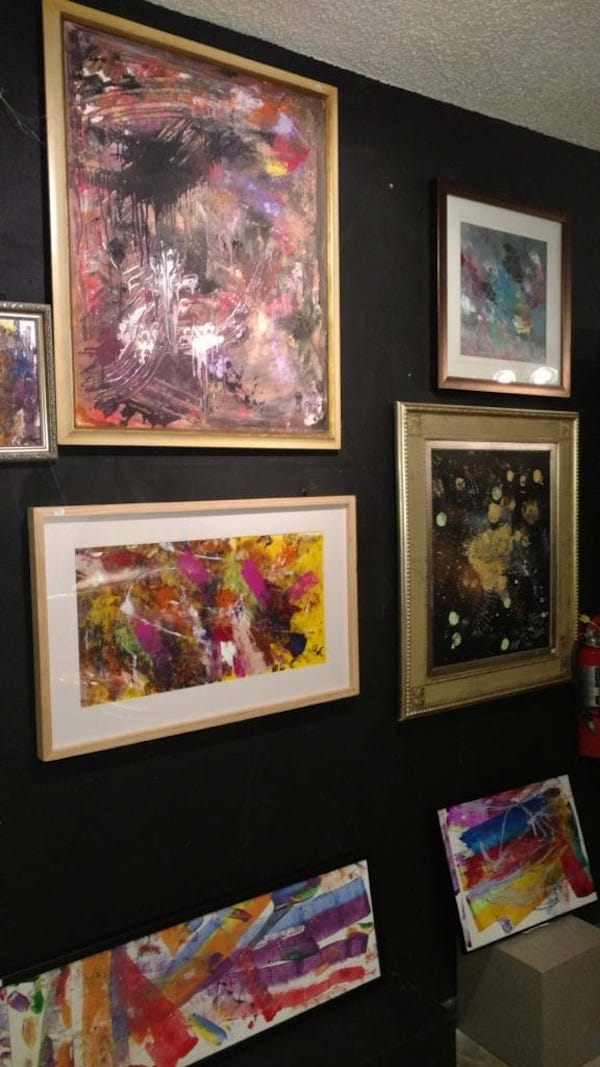 Colorful, framed pieces of work by Abstract Art for Autism students.