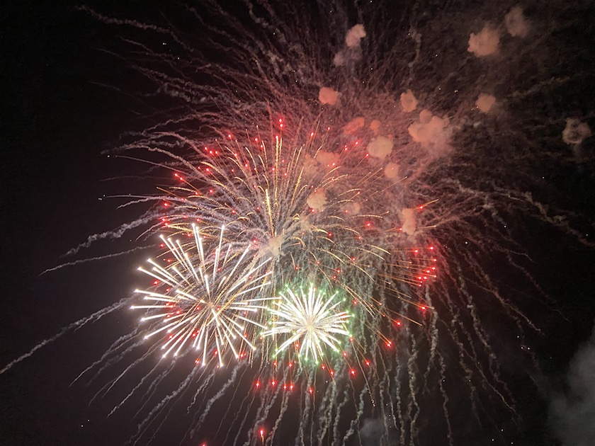 Red and white fireworks in a night sky