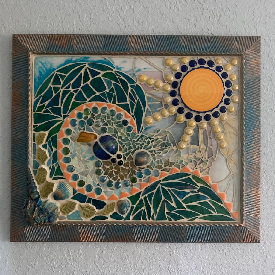 A mosaic tile art in a rectangular frame depicting wave and a sun