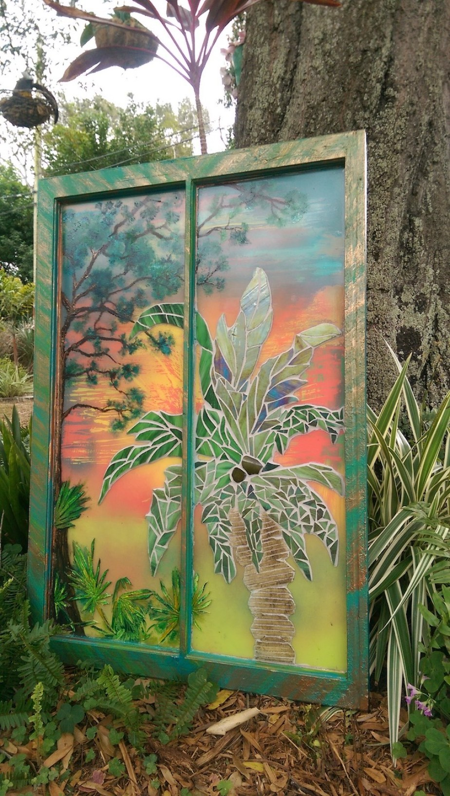 A piece of colorful outdoor art in a rectangle frame