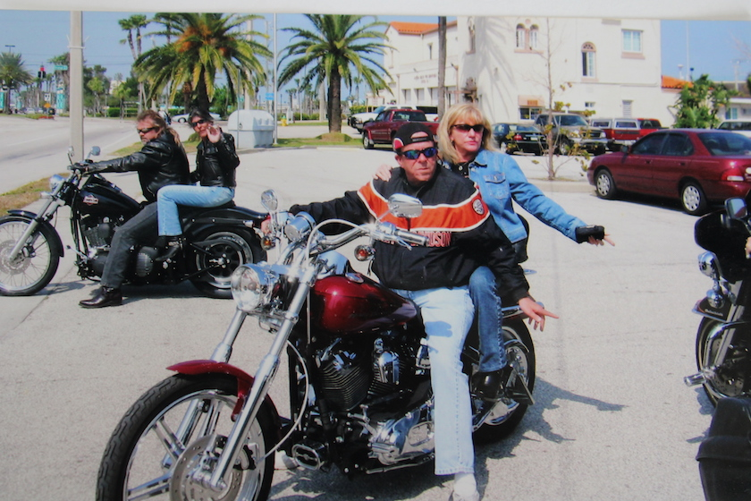 A man and woman on a motorcycle