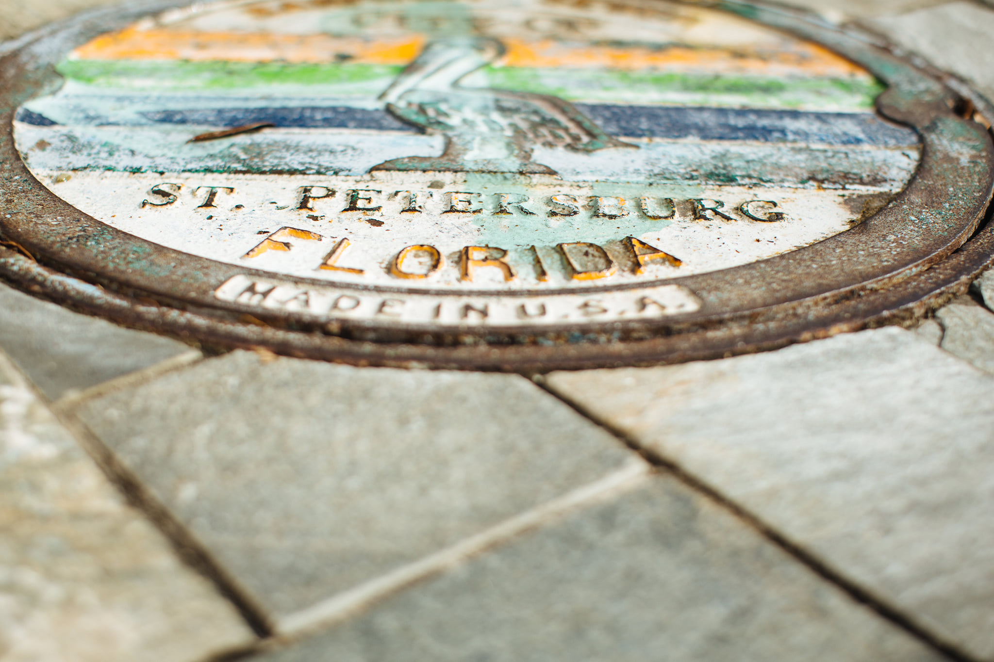 A colorful manhole cover from the city of St. Petersburg Florida