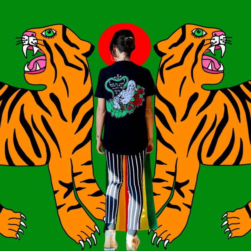 An abstract art piece with two orange tigers and w woman with her back turned in a green background