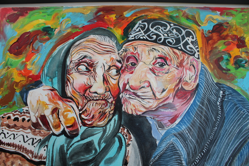 A colorful painting of an old man and woman