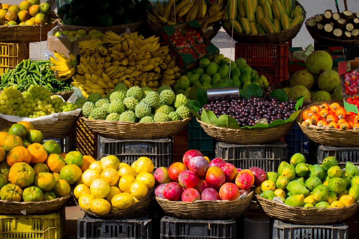 Fruits and vegetables in brown baskets.