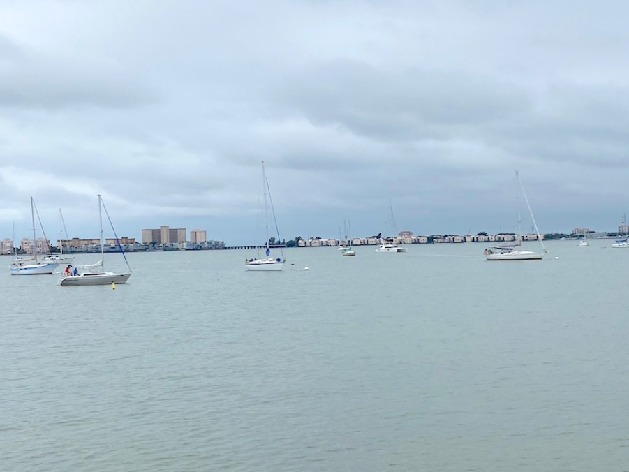 Boats in a by on an overcast day