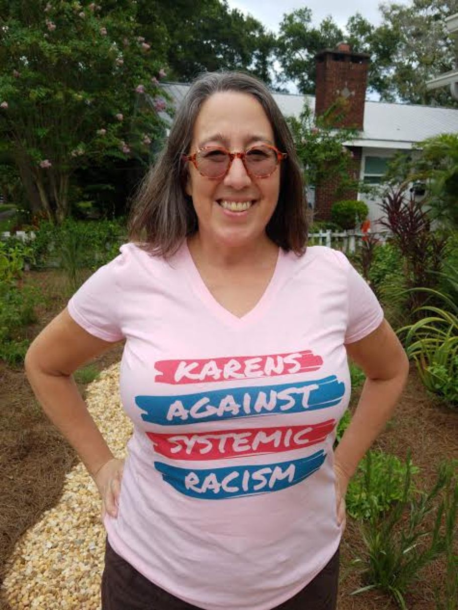 A woman in a pink t-shirt that says Karens Against Systemic Racism