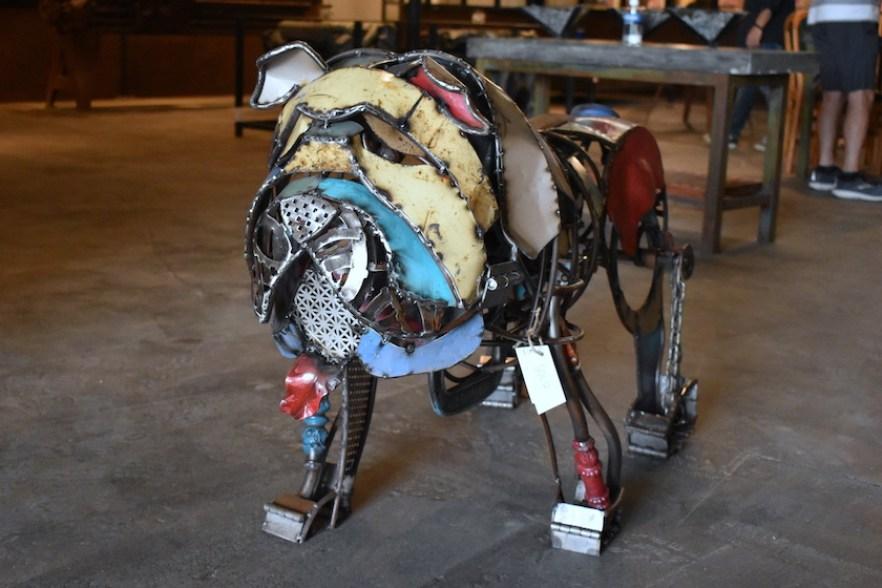 A multicolored metal sculpture of a bulldog