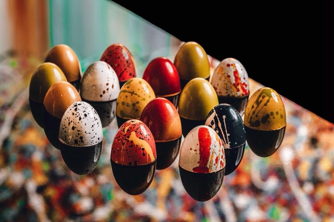 A group of colorful and artistically decorated chocolate eggs.