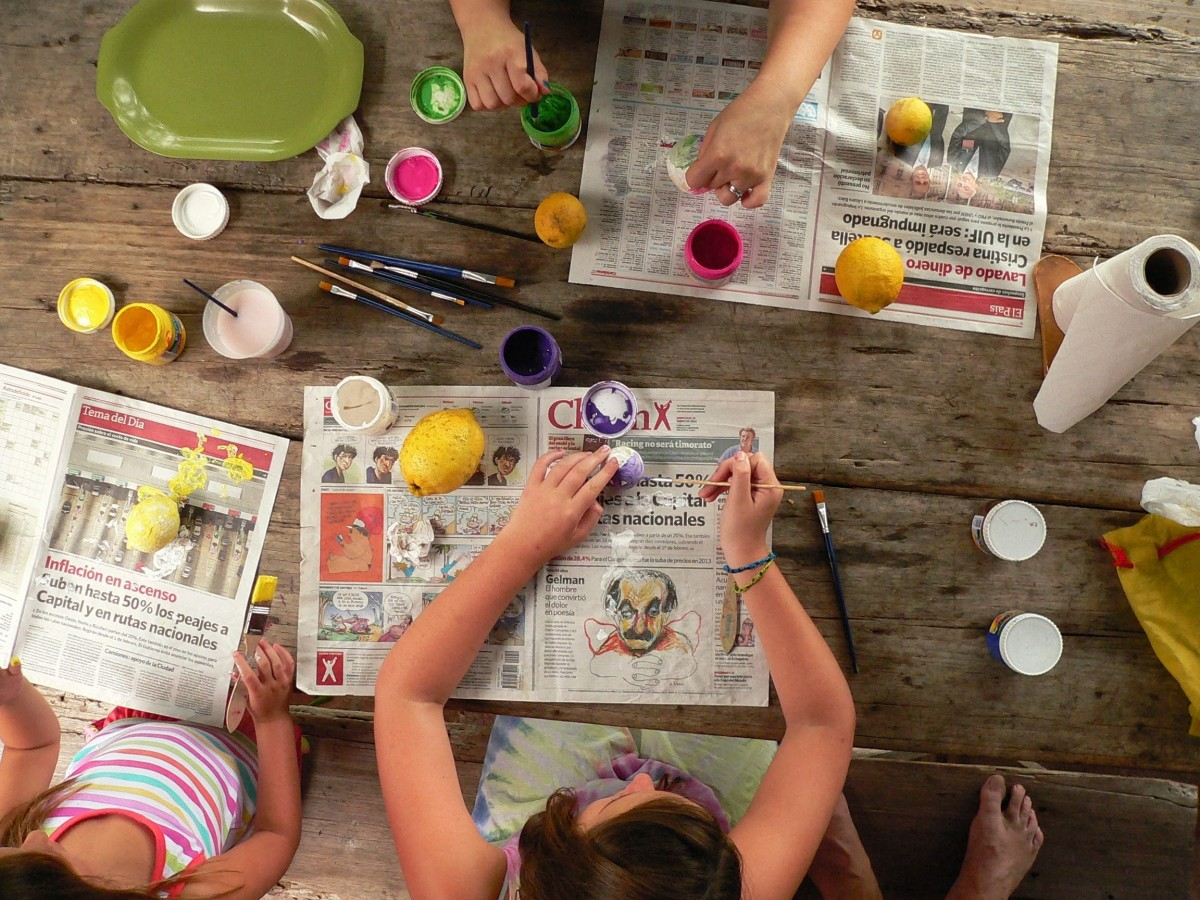 Kids doing arts and crafts at a table
